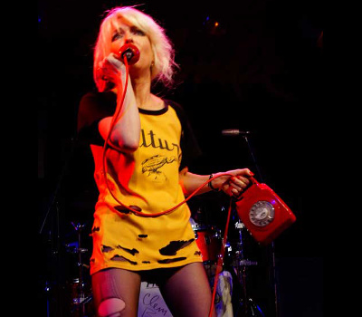 Thursday 9th December 2021, 8:00pmRescheduled from Fri 21st May 2021All Seats £18.00BOOTLEG BLONDIE is the world's No.1 official Debbie Harry & Blondie tribute bandEstablished in 2001 this band are the only Blondie tribute to play the legendary CBGB in New York City before it's demise in 2006 and unique in that not only have they had the honour to be thanked on Blondie's 11th album Pollinator but have actually played not one but two tours in the UK with Blondie's legendary drummer Clem Burke, under the band name CBBB (Clem Burke & Bootleg Blondie).Debbie and the boys have met the REAL Blondie many times. Debbie Harry wished them good luck with their show for their gig at CBGB NYC back in 2006 and when Andy and Debbie got married they received two video messages from both Blondie and Debbie Harry herself congratulating them on their wedding day. What a Blondietastic wedding present! Debbie Harris, lead vocalist of Bootleg Blondie, has the looks, the voice and the attitude of the original Blondie bombshell and like her heroine is typically outrageous on stage. She has been known to wear dustbin liners, thigh length boots and t-shirts with more holes than t-shirt!  Debbie's pride and joy is her guitar which she plays at every show and is signed by all the Blondie band members. She appeared recently in the Mail On Sunday EVENT Magazine and performed on two shows for BBC1 when she was picked out of 15,000 applicants to represent Debbie Harry on 'Even Better Than The Real Thing' hosted by Paddy McGuinness which attracted an audience of 10 million viewers!All prices advertised include a booking fee. No fees to Friends of the Floral. A postage fee may apply.
