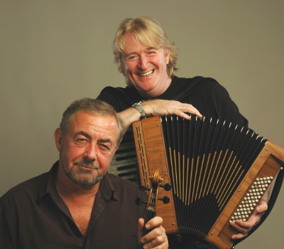 "Saturday 9th October 2021, 7:30pmRescheduled from Sat 10th Oct 2020All Tickets £21.75""They are simply the best traditional musicians you are ever likely to hear"" Mike Russell  - The Glasgow HeraldHaving toured together since 1986 to packed concert halls all over the world, the pair have won the BBC Radio 2 Folk Awards – BEST DUO Award and been nominated in the Scottish Traditional Music Awards for 'Live Act of the Year'Aly was a founder member of the 'Boys of the Lough' and his passionate fiddle playing has also found its way onto recordings by the likes of Eddi Reader and Richard Thompson. He was responsible for launching 'The Transatlantic Sessions' TV series in which both he and Phil continue to feature. Accordion player Phil has been named as one of Scotland's 25 most influential people and his mastery of the instrument has led to him working with the likes of Mark Knopfler, James Taylor, Rosanne Cash and Midge Ure.  Together they are simply the best traditional musicians you are ever likely to hear. All prices advertised include a booking fee. No fees to Friends of the Floral. A postage fee may apply."