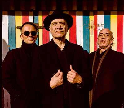 Thursday 10th February 2022, 8:00pmRescheduled from Thu 25th Feb 2021Tickets £34.25Following a remarkable recovery from a diagnosis of terminal cancer, Wilko Johnson the original Dr Feelgood guitarist, actor (Game of Thrones character Ser Ilyn Payne) and all round national treasure has enjoyed a rousing return to the live arena, including a number 1 album with Roger Daltrey (Going Back Home), a sold out show at The Royal Albert Hall to mark his 70th birthday and, most recently, the release of Blow Your Mind, his first album of new material in decades. Wilko is famed for his blistering chop-chord strumming action (the 'stab', as he describes it), a technique inspired by his admiration of the late Pirates guitarist Mick Green. With this electrifying sound, his trademark black-suited, scowling look and his characteristic strut, Wilko became one of the guitar heroes of the 1970s and beyond, not to mention on of rock 'n' roll's most extraordinary characters. He, alongside his original Feelgood bandmates, is also widely acknowledged as a forefather of punk on both sides of the Atlantic, fans ranging from Joe Strummer to Blondie.Following a stint with Ian Dury & The Blockheads in the 1980s, he formed the Wilko Johnson Band, with Blockheads bassist Norman Watt-Roy. Featuring former Blockhead Dylan Howe on drums, the trio is known as one of the most exciting R'n'B bands in the world today. Special guest 'Rock and Roll's Greatest Failure John Otway.All prices advertised include a booking fee. No fees to Friends of the Floral. A postage fee may apply.