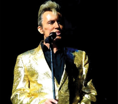 "Wednesday 27th October 2021, 7:30pmRescheduled from Thu 15th Jul 2021Adults £26.25Under 16's Only £5.00One of the best-selling recording artists of the 1960s, Billy Fury enjoyed a string of hit singles totalling a remarkable 332 weeks in the British charts. Health problems since childhood led to the singer's untimely death on January 28, 1983. Hailed as ""the best Fury since Fury"", Michael King and his fantastic collection of musicians take you on a journey through the musical career of Britain's best loved rock n roll legend. An exciting 2 hour show filled with Billy Fury's greatest hits and more delivered live in true Fury style. This is a night of pure breath-taking Billy Fury entertainment plus the best Fury sound you will hear!The whole show is further enhanced by fantastic audio and video effects plus various costume changes depicting the ever changing image and face of the Fury phenomenon. ""The songs span Fury's entire career from his initial record release (Maybe Tomorrow) through to his final one, Forget Him - which, thanks to this thoughtful and welcome tribute show, his legion of fans never will"" - Lee Wilkinson. The Stage ""King captured fully the sound, the gestures, the mannerisms, even the physical appearance of arguably Britain's greatest Rock and Roll singer"" - The Beat Magazine All prices advertised include a booking fee. No fees to Friends of the Floral. A postage fee may apply."