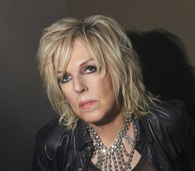 "Tuesday 17th August 2021, 7:30pmRescheduled from Tuesday 18th August 2020All Seats £29.25""It's all come full circle,"" says Lucinda Williams about her powerful new album, Good Souls. Better Angels. After more than forty years of music making, the pioneering, Louisiana-born artist has returned to the gritty blues foundation that first inspired her as a young singer-songwriter in the late 1970s. After spending the last year on her sold-out 'Car Wheels on a Gravel Road' 20th Anniversary tour, Williams has reunited with that game-changing 1998 album's co-producer and engineer Ray Kennedy, recording Good Souls, Better Angels with her ace touring band at his Nashville studio. Joining them as co-producer is Williams' manager Tom Overby, to whom she's been married for a decade and who contributed lyrics to her masterful songcraft. 'That's what I always dreamed of – a relationship with someone I could create with', Williams enthuses.The result – Good Souls, Better Angels – is the most topical album of Williams' career. From the driving blues of the opening track You Can't Rule Me to the ominous gothic Pray the Devil Back to Hell, from punk-blues-fuelled Bone of Contention to fire 'n brimstone Drop by Drop (Big Rotator), Williams has never been more raw and direct, with gut-punching wordplay crossing the Good Book with hip-hop with Ginsbergian beat poetry.Giving voice to all her experience, Williams ends Good Souls, Better Angels with the luminous Good Souls,  one of the last songs written for the album. It is a deeply moving invocation: ""Keep me with all of those/who help me find strength/when I'm feeling hopeless/who guide me along/And help me stay strong and fearless.""  All prices advertised include a booking fee. No fees to Friends of the Floral. A postage fee may apply."