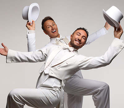 Monday 4th October 2021, 7:30pmRescheduled from Sat 24th October 2020Front Stalls £35.75 - Rear Stalls £31.75VIP Tickets £61.75Group rates available The Ballroom Boys double act Ian Waite and Vincent Simone are set to return in 2021 with a brand new show - Ian Waite and Vincent Simone... ACT TWO, after the roaring success of their 5 star rated 2019 tour!The fabulous Strictly Come Dancing stars promise another wonderful evening of old-fashioned variety - dance, comedy and song!With beautiful costumes, gorgeous lighting and world class routines, including the Viennese Waltz, the Foxtrot, the Rhumba… and of course… there has to be another incredible Argentine Tango routine by the master! The boys will be joined by their stunning dance partners and a world class singer.If you enjoyed The Ballroom Boys, then make sure you don't miss the hilarious dancing duo when they bring you... ACT TWO!***** WORLD-CLASS The News Letter ***** A HUGELY ENTERTAINING NIGHT OUT Crawley Observer***** WHAT A SHOW! Elementary Whats OnReviews from the 2019 productionVIP Meet and Greet information -There are a limited number of VIP Meet and Greet tickets available.Don't miss your chance to meet Ian & Vincent BEFORE the show (90 minutes prior to the performance) for photo and autograph opportunities, plus a signed print and VIP lanyard.*Please arrive at least 10 minutes before the meet and greet start time, as latecomers may not be permittedAll prices advertised include a booking fee. No fees to Friends of the Floral. A postage fee may apply.