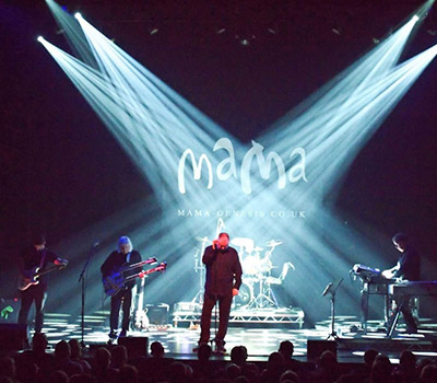 "Friday 27th August 2021, 7:30pmTickets £21.75One of the UK's most successful Genesis tribute bands, Mama faithfully reproduce the sights and sounds of a high octane, contemporary Genesis rock concert with fantastic musicianship from acclaimed musicians.Mama will take you on a journey from Genesis' early Peter Gabriel years, through the Phil Collins' era of the 70's and 80's and right up to their final studio album, 'We Can't Dance'.Expect to hear Genesis classics, In The Cage Medley, Mama, Los Endos, Home By The Sea, The Lamb Lies Down On Broadway, Ripples and many more, with bonus tracks such as Follow You Follow Me, In The Air Tonight, Sledgehammer, No Son Of Mine, Land Of Confusion and Suppers Ready.Lead singer, John Wilkinson, delivers the Phil Collins vocal sound with power, passion and precision. On keyboards, the band benefits from the technical wizardry of John Comish. Guitars are provided by Jon Vatikiotis, backed up with the rock solid technical playing of James Cooper on drums and Dave Jones on bass, 12 string guitar and bass pedals.When asked about the show, John Wilkinson said, ""The idea of a Mama show is to celebrate the music of Genesis by having a Genesis party. We are huge Genesis fans, just like our audience. It's great to meet so many likeminded Genesis fans as we tour the UK year after year. They know what they like!""All prices advertised include a booking fee. No fees to Friends of the Floral. A postage fee may apply."